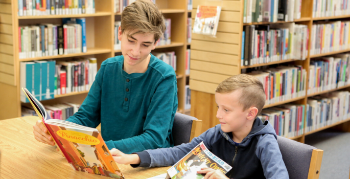 Book pal volunteer with child