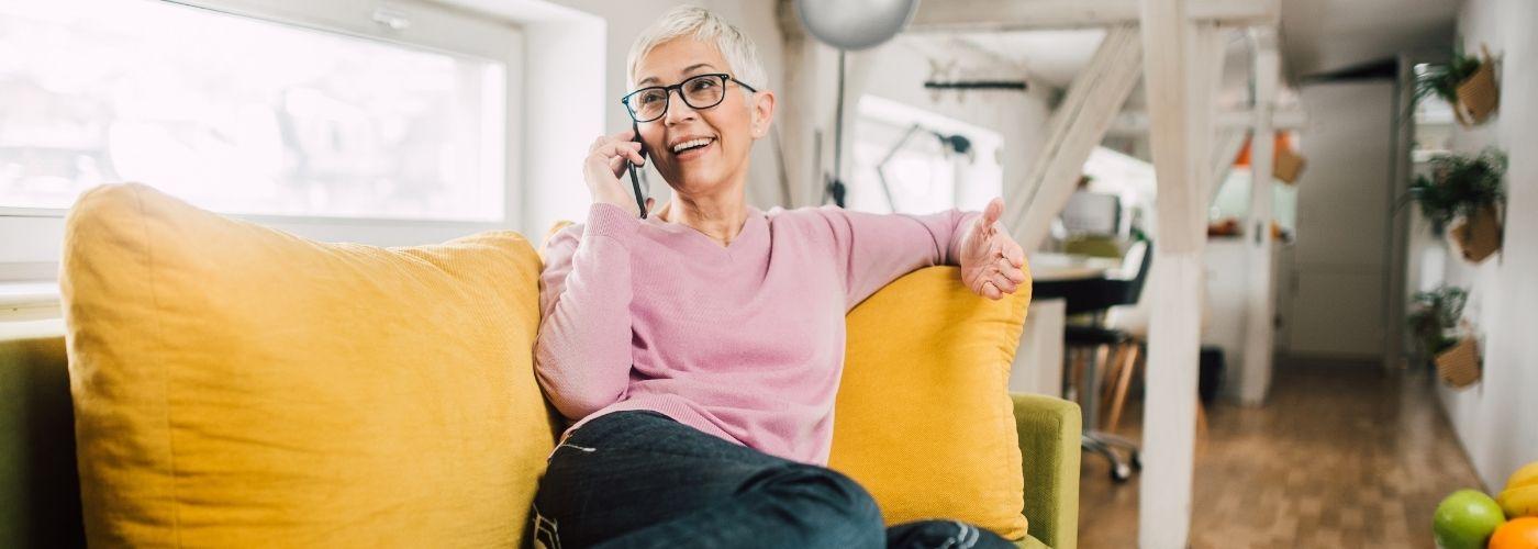 senior talks on the telephone