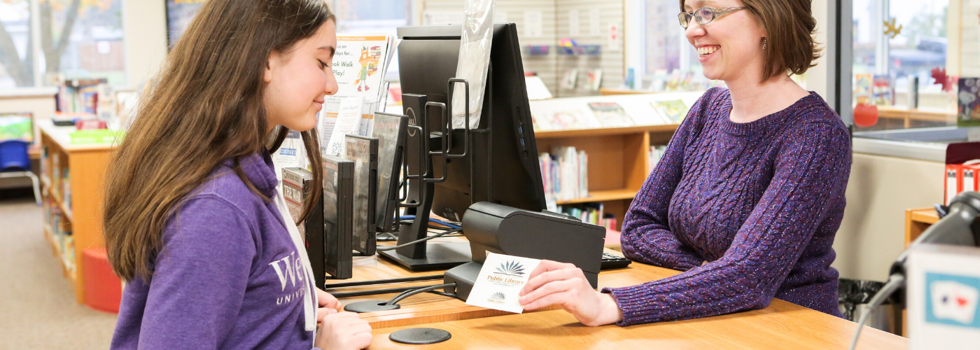 Teen getting a library card